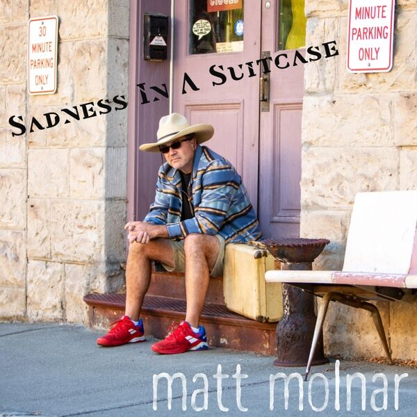 Cover art for Sadness in a Suitcase